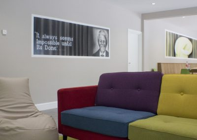 The International Hostel Knock County Mayo Seating area with Nelson Mandela Mural